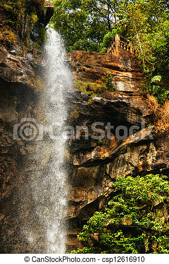 Sacred waterfall of tropical forest - csp12616910