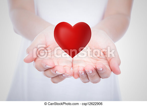 Heart on woman hands over body  - csp12622906