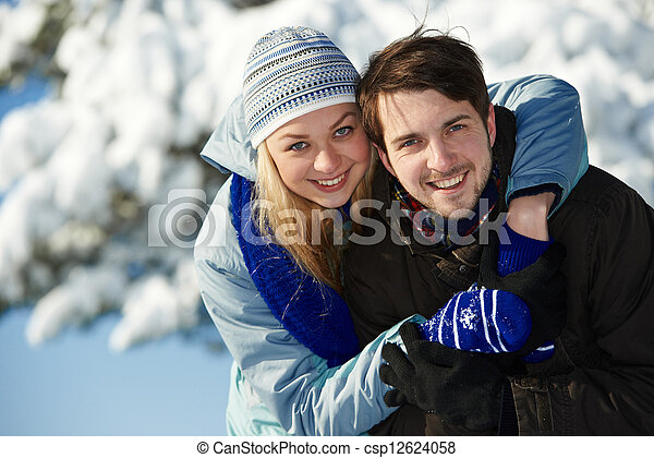 young happy couple people in winter - csp12624058