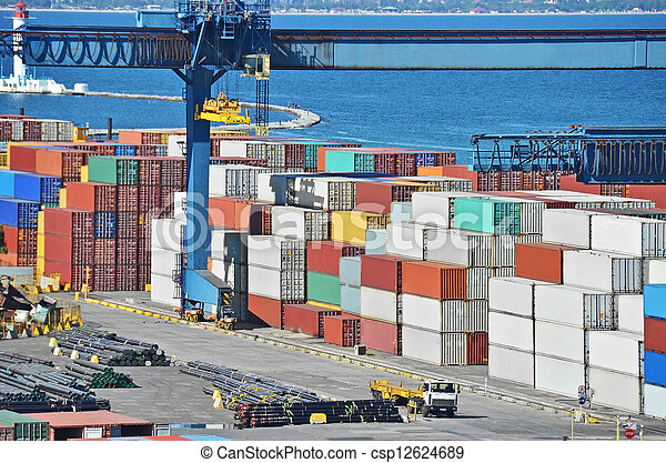 Port cargo crane and container over sea sky background