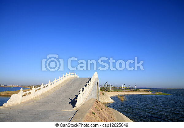 bridges in the lake water, in the blue sky - csp12625049