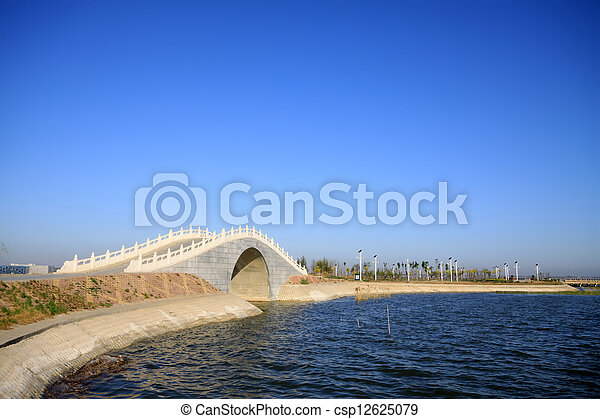 bridges in the lake water, in the blue sky  - csp12625079
