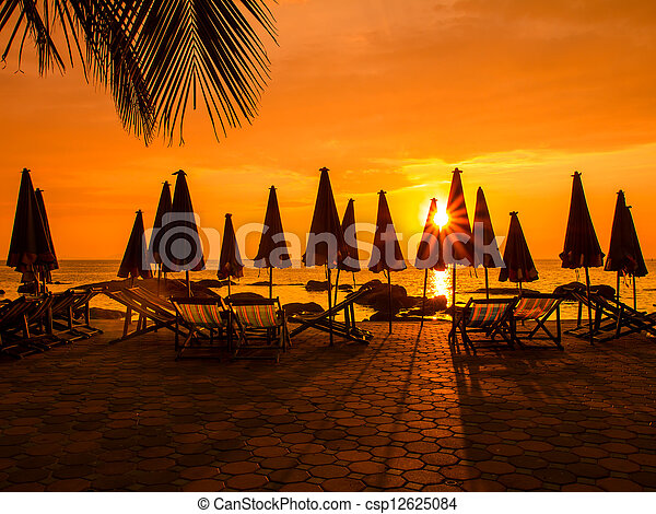 Beach chairs in evening at sunset - csp12625084