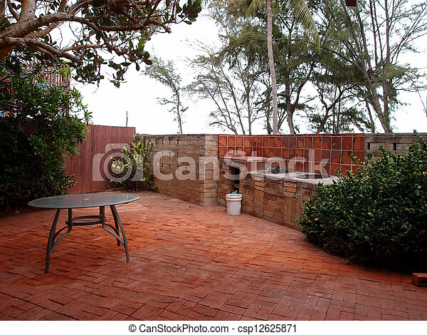 ... Red Brick Patio With BBQ Pits And Table Surrounded By Trees
