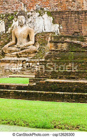 An image of Buddha in Sukhothai Historic Park - csp12626300