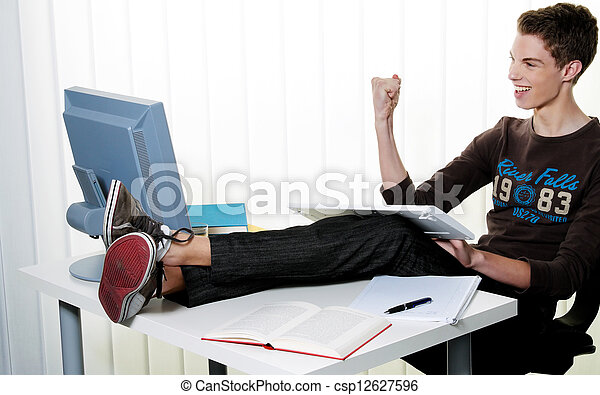 young man with computer - csp12627596
