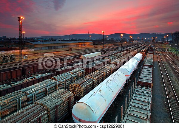 Cargo train platform at sunset with container - csp12629081