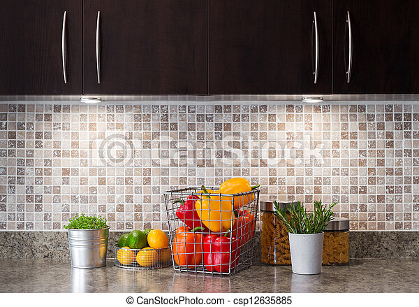 Vegetables, fruits and herbs in a kitchen with cozy lighting - csp12635885