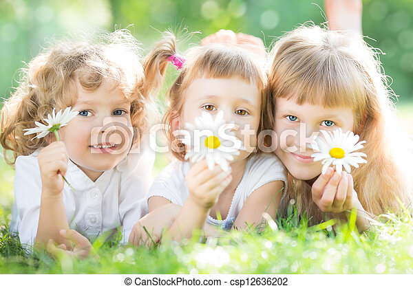 Children with flowers in park - csp12636202
