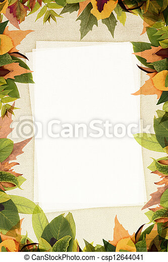 Autumn leaves frame on fabric texture with copy space