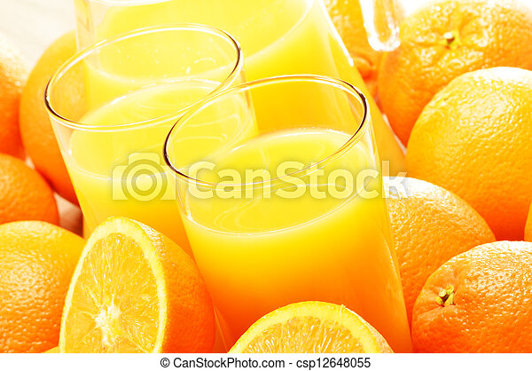 Composition with two glasses of orange juice and fruits - csp12648055