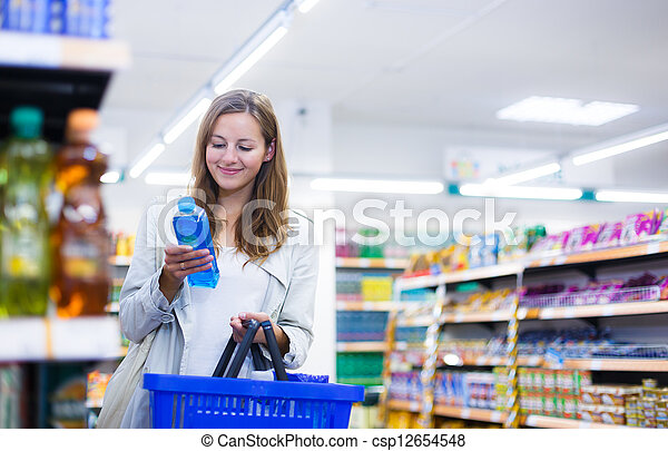 Beautiful young woman shopping in a grocery store/supermarket - csp12654548