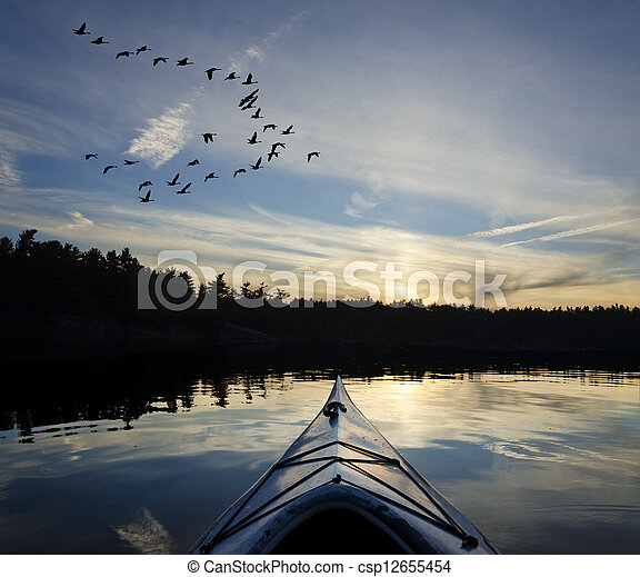 Kayak and Geese at Sunset - csp12655454