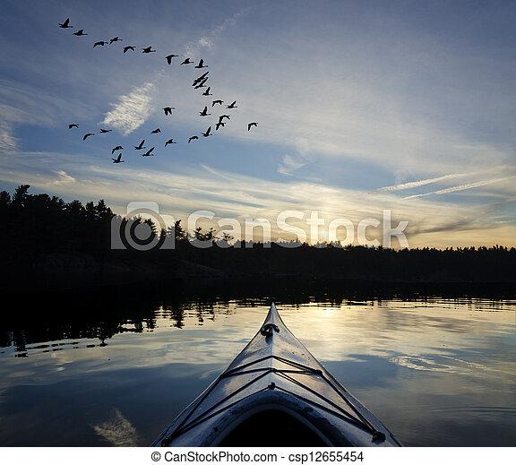 Kayak and Geese at Sunset - csp12655454