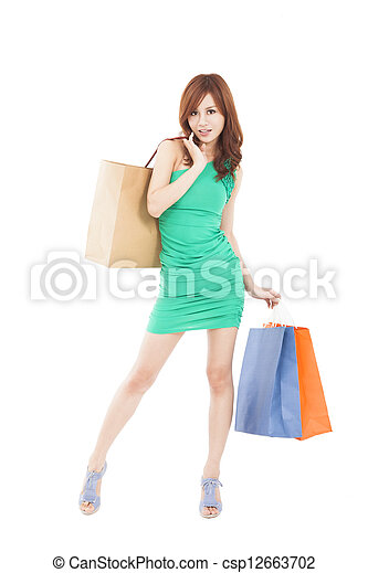 full length of happy young woman with shopping bag - csp12663702