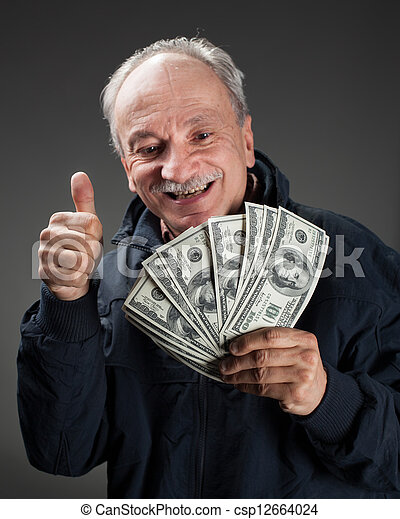 Happy elderly man showing fan of money - csp12664024