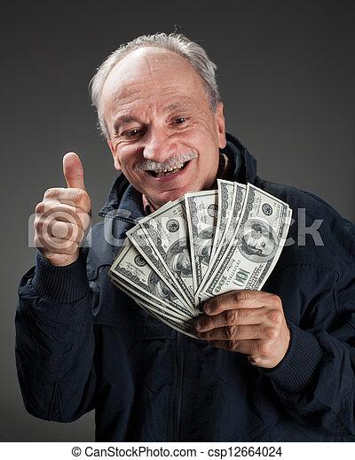 Happy elderly man showing fan of money - csp12664024