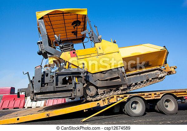 Transportation tracked paver machin - csp12674589