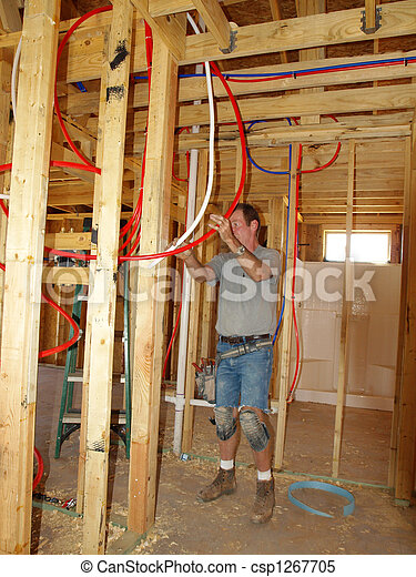 Stock images of plumber installing pex plumbing in new for New construction plumbing