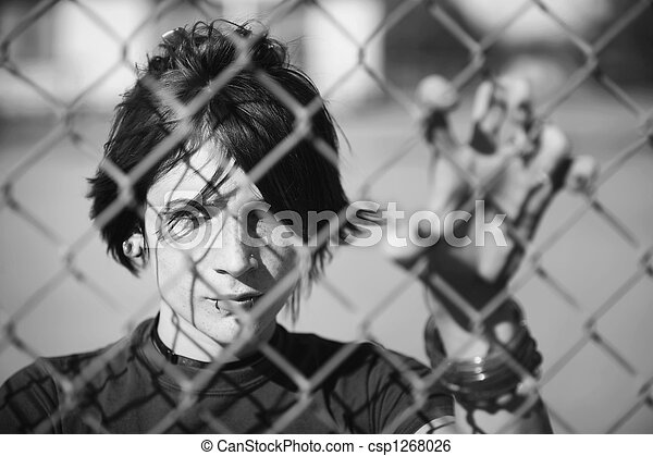 Punk Girl Behind Chain Link - csp1268026