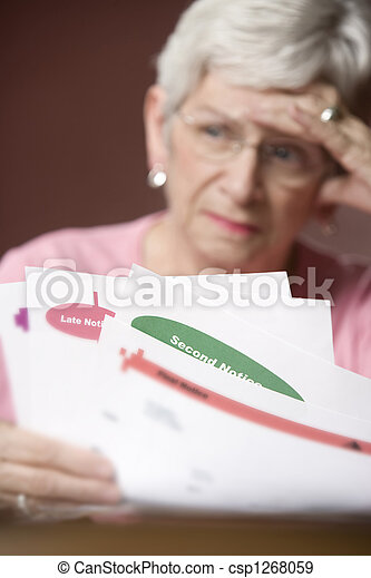 Senior woman with bills and notices - csp1268059