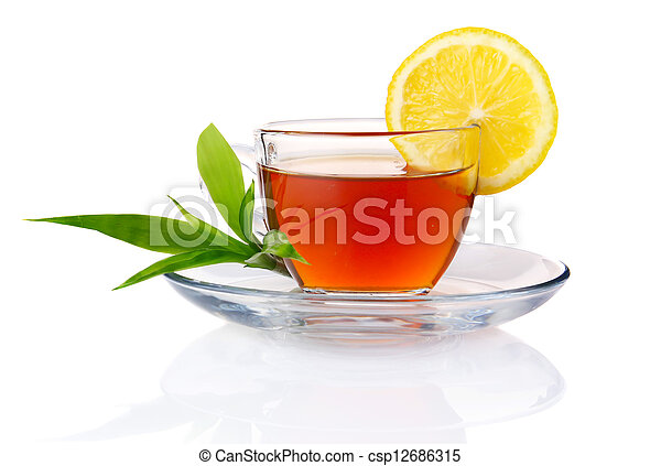 Cup of black tea with lemon and green leaves isolated - csp12686315