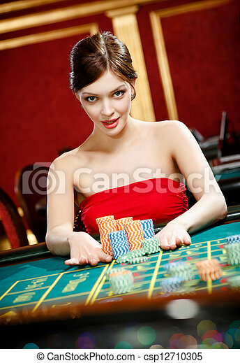 Woman placing a bet at the gambling house - csp12710305