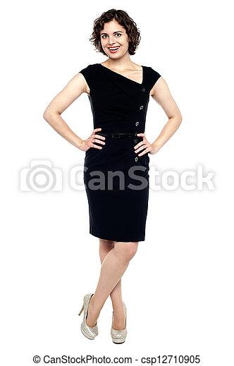 Beautiful young sensuality woman in black dress - csp12710905