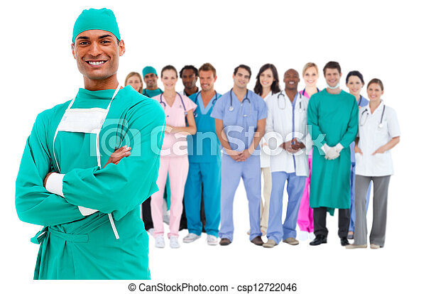 Smiling surgeon with medical staff behind him - csp12722046