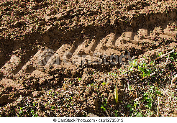 tractor mark trail soil agriculture field  - csp12735813