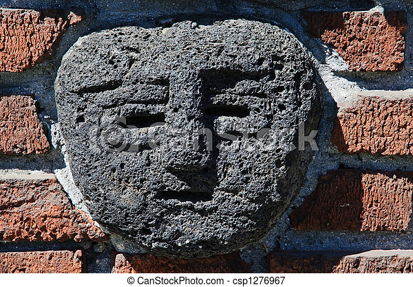 Picture of ancient american stone bas relief brick wall for American brick and stone