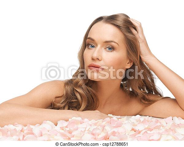 beautiful woman with rose petals - csp12788651