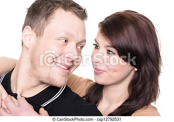 Young and happy couple in front of white background - csp12792531