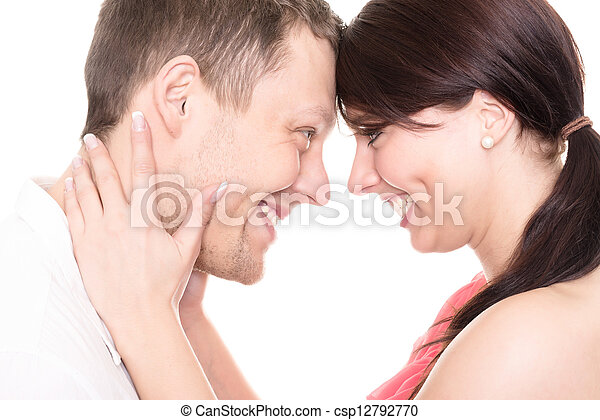 Young and happy couple in front of white background - csp12792770