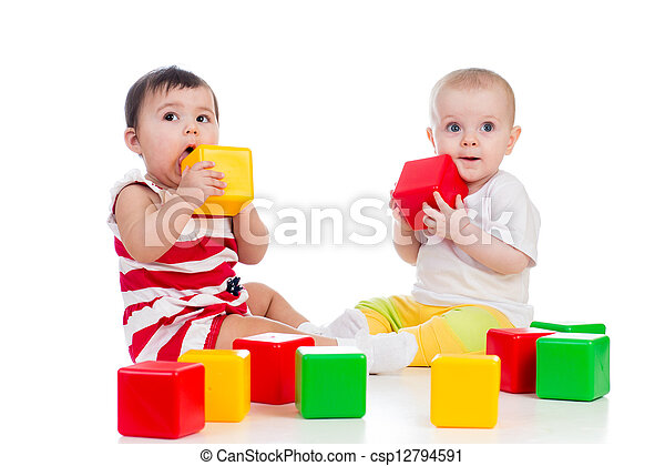 two babies girls playing together with color toys  - csp12794591