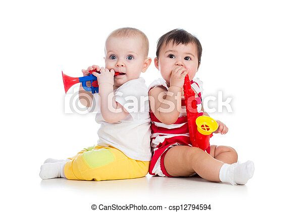 Funny babies girls  with musical toys. Isolated on white background - csp12794594