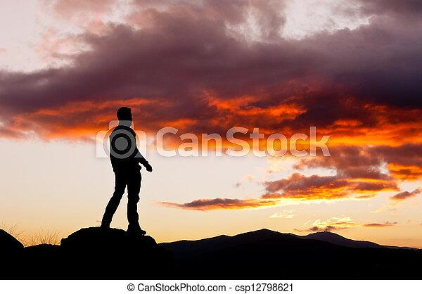 Man contemplating a mysterious sky - csp12798621