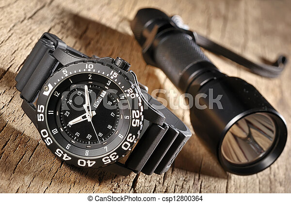 military watch and flashlight - csp12800364