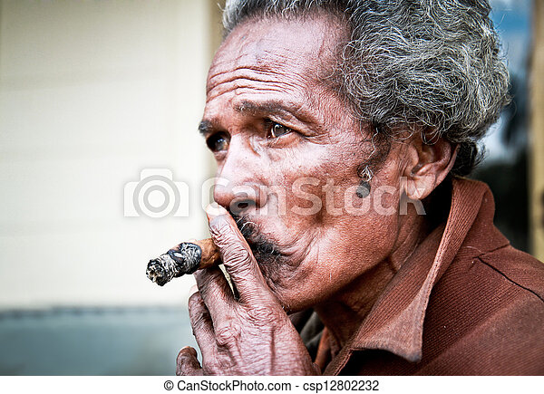 SANTA CLARA, CUBA-JAN 10:Unidentified Cubans smoking cigar on Jan  10. 2010.Santa Clara, Cuba.Cubans of all ages are actively smoking cigars.All production in Cuba is controlled by the Cuban government - csp12802232