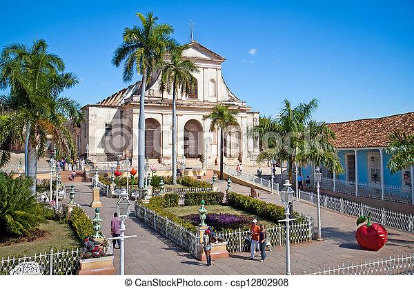 Tourists admire typical architecture  in Trinidad, Cuba.  - csp12802908