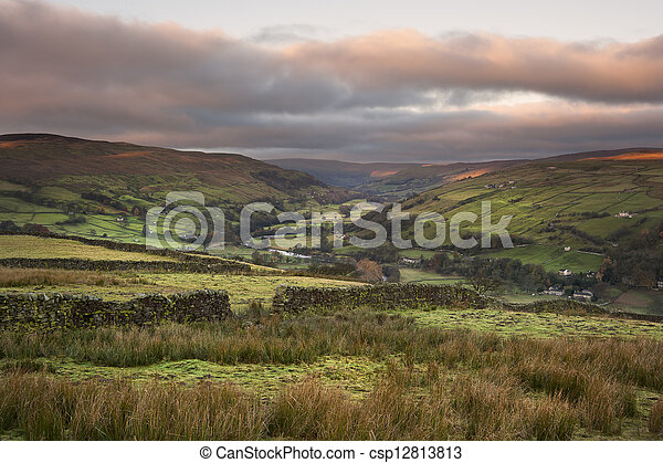 View along Swaledale in Yorkshire Dales National Park during Autumn sunrise - csp12813813