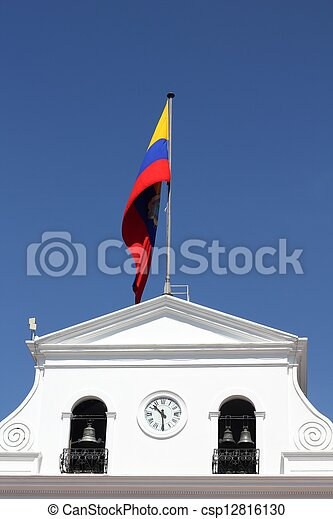 Government building and waving flag of Ecuador in Quito, Ecuador
