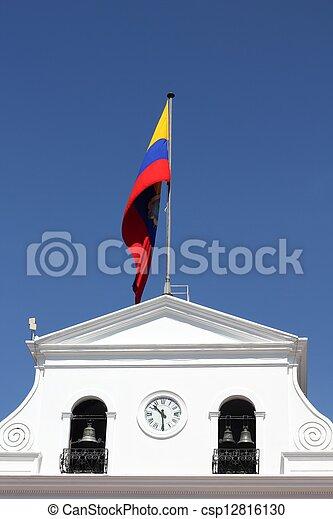 Government building and waving flag of Ecuador in Quito, Ecuador - csp12816130
