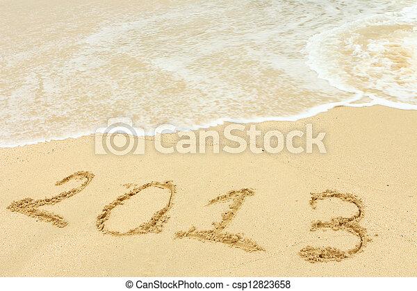 2013 written in sand on beach  - csp12823658
