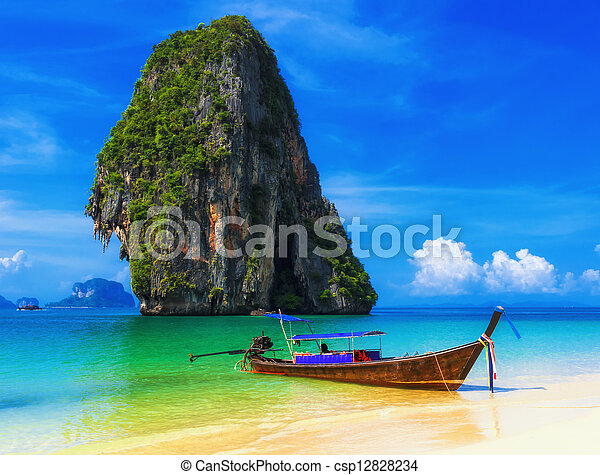 Thailand exotic tropical beach. Blue sky, sand and traditional boat - csp12828234