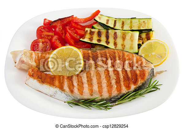 grilled fish with vegetables on the plate - csp12829254