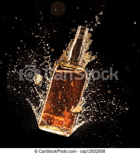 Concept of liquor splashing around bottle, isolated on black background - csp12832938