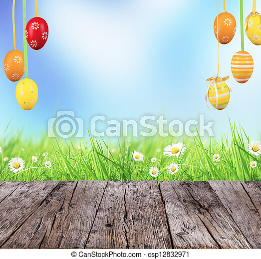 Easter concept with colored eggs and wooden planks - csp12832971