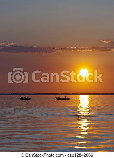 Fishing Boats at sunset - csp12842066