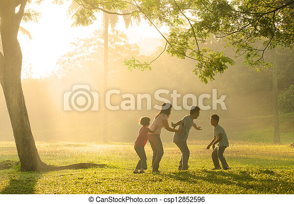 chinese family having quality time playing at outdoor park - csp12852596